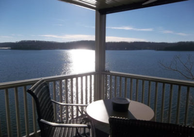 view of deck with lake in background