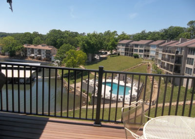 view of lakefront pool from deck