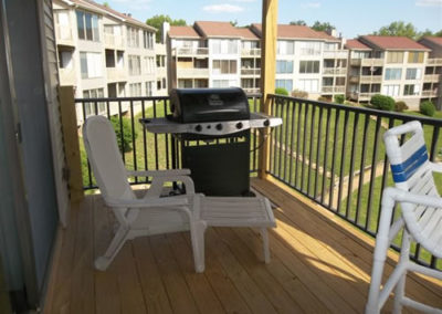 view of deck with grill with other buildings in background