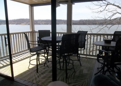 view of deck with the lake in background